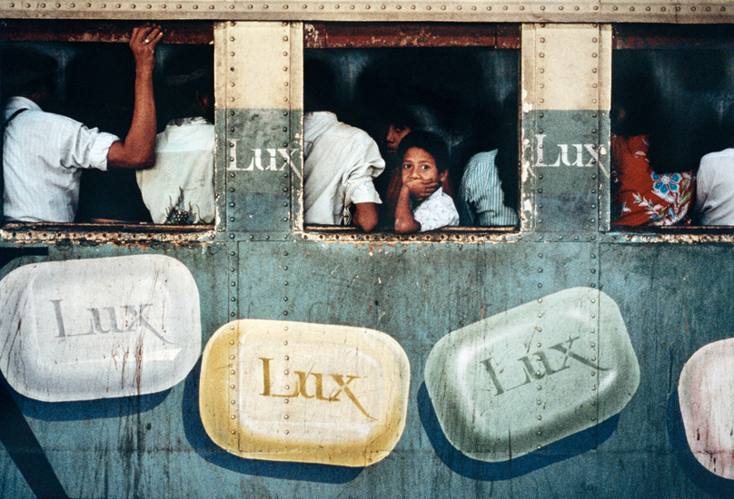 CHILD LOOKING OUT OF A TRAIN CARRIAGE. Fuji Crystal. Limited Edition
